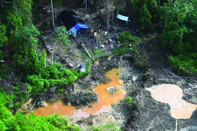 An unauthorised gold-prospecting site in operation in 2017 in French Guiana. © Parc Amazonien de Guyane