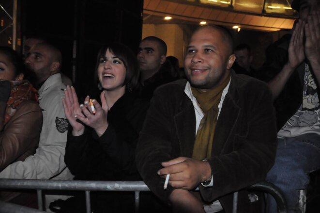 Aurore Van Opstal et Olivier Mukuna à un concert du groupe IAM à Bruxelles en 2012