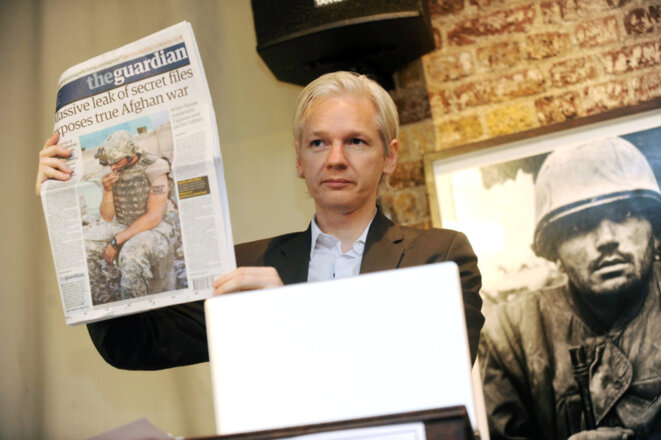 A file photograph showing WikiLeaks founder Julian Assange shows an issue of the British daily newspaper The Guardian during a press conference at the Frontline Club in London, Britain, 26 July 2010. EPA/STR