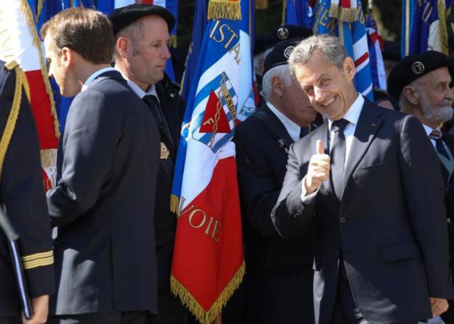 Emmanuel Macron et Nicolas Sarkozy à Thones (Haute-Savoie), le 31 mars. © Reuters