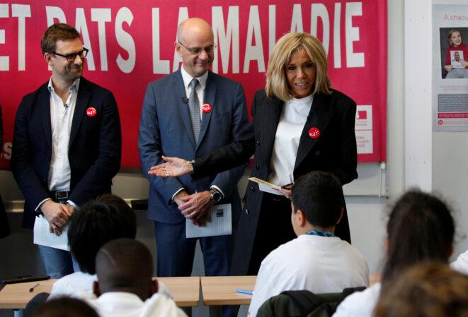 Jean-Michel Blanquer et Brigitte Macron font une dictée. © Reuters