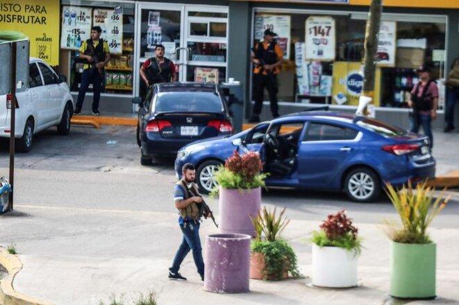 Des hommes armés membres du cartel de Sinaloa jeudi 17 octobre à Culiacan, dans l'État de Sinaloa (Mexique).
