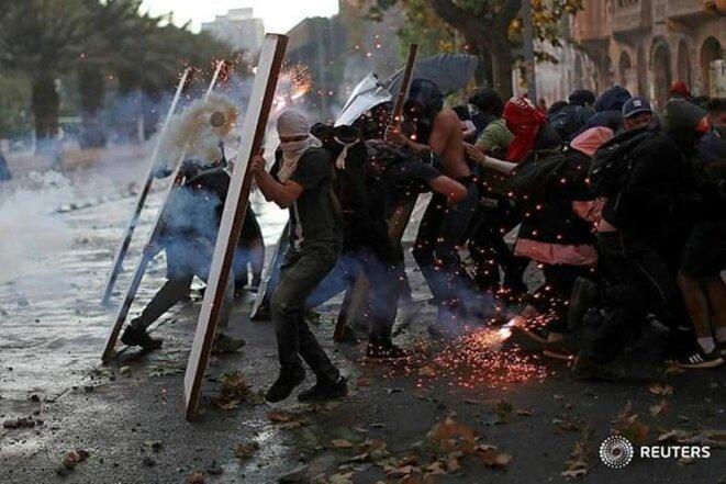 Manifestant ataqués par la represion policiale. © inconnu