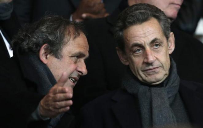 Michel Platini et Nicolas Sarkozy au Parc des Princes pour un match du PSG, le 17 février 2015. © Reuters