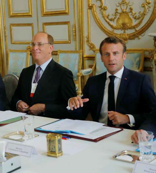 Larry Fink (BlackRock) et Emmanuel Macron à l'Elysée en juillet 2019 © Reuters