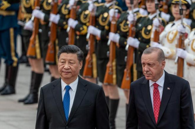 Le président chinois Xi Jinping et son homologue turc Recep Tayyip Erdogan lors de la visite de ce dernier en Chine en juillet 2019. © REUTERS
