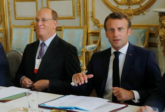 Larry Fink (BlackRock) et Emmanuel Macron à l'Elysée, en juillet 2019. © Reuters