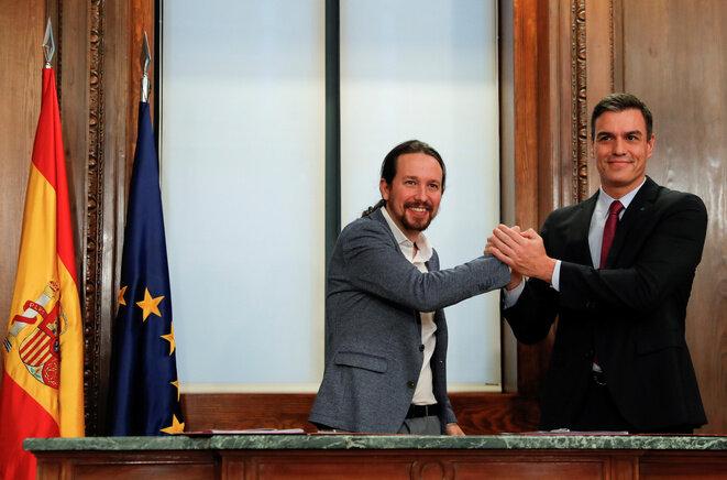 Pablo Iglesias y Pedro Sánchez, el 30 de diciembre de 2019 en Madrid. © Reuters/Susana Vera