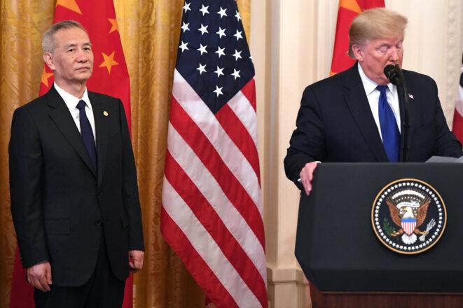 Donald Trump et le vice-président chinois le 15 janvier. © Saul Loeb/AFP
