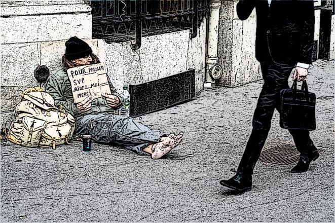 7780535918-un-sdf-dans-les-rues-de-paris-en-mars-2015
