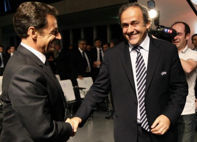 Nicolas Sarkozy (l) and Michel Platini in Geneva, May 28th 2010. © Reuters