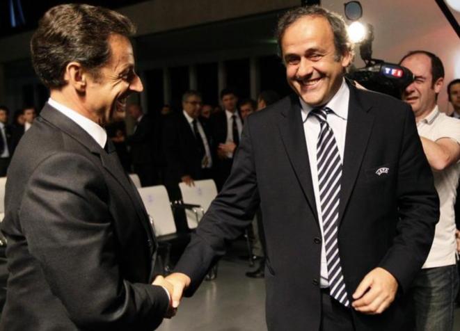 Nicolas Sarkozy et Michel Platini le 28 mai 2010, à Genève. © Reuters