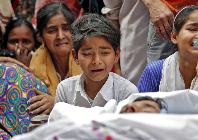 Funérailles d'une victime des violences contre les musulmans à New Delhi. © REUTERS