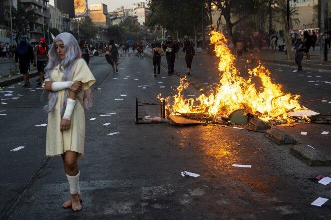 Manifestation contre le président Sebastián Piñera le 28 février à Santiago. © MARTIN BERNETTI/AFP