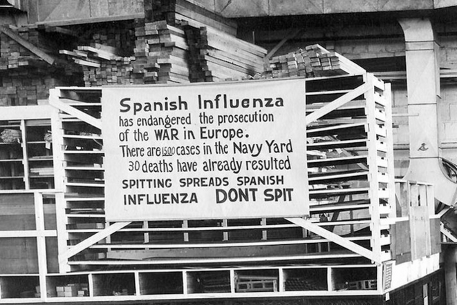 A sign from October 1918 at the Navy Yard in Philadelphia warning people not to spit. © DR