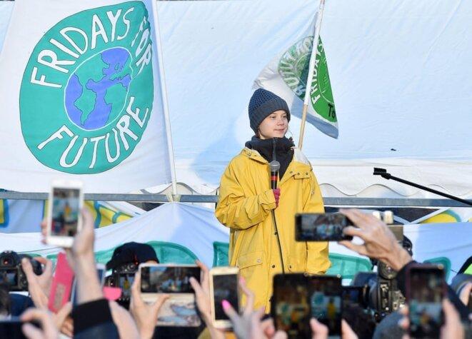 Décembre 2019, l'activiste suédoise Greta Thunberg dirige un rassemblement des Vendredis pour le Futur à Turin. © Photographie : Alessandro Di Marco/EPA