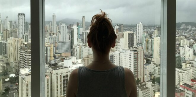 woman-standing-near-glass-window-763849-scaled-e1584293610381-1024x509