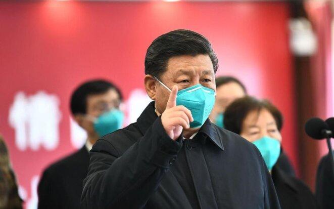Xi Jinping à Wuhan. Il ne se rendra dans la Ville que le 10 mars. © AFP