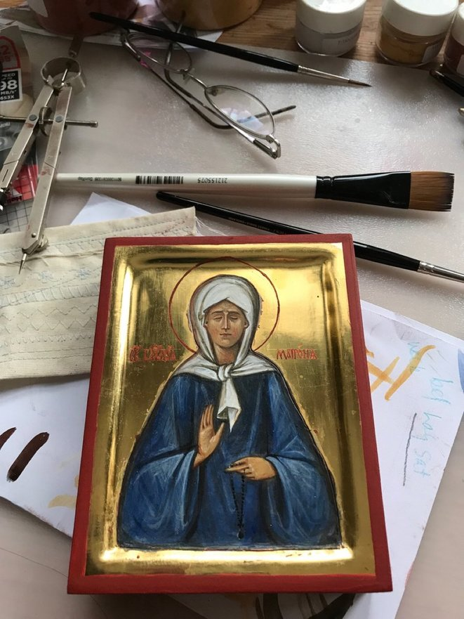 Tiny icon of Orthodox Saint Matrona of Moscow, hand painted in gold leaf and egg tempera. © Katherine Sanders
