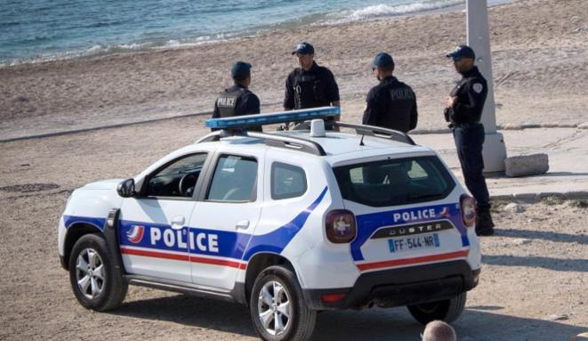 Photo d'illustration : un contrôle de police pendant le confinement, à Marseille, en mars. © AFP.