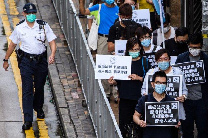 Des manifestants dénoncent la prochaine loi sur la sécurité nationale à Hong Kong le 22 mai 2020. © Anthony Wallace/AFP