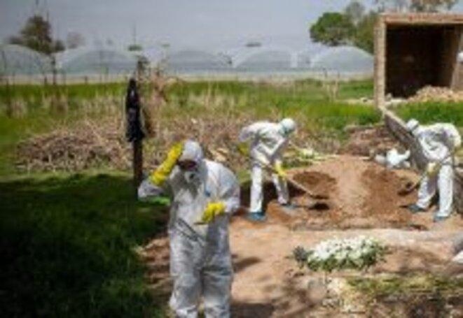 coronavirus-iran-cemetery-218x150