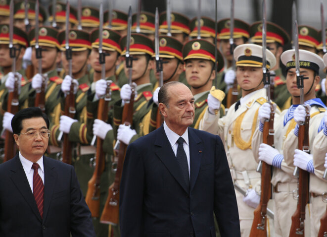 Then Chinese president Hu Jintao and his French counterpart Jacques Chirac in Beijing, October 26th 2006. © AFP