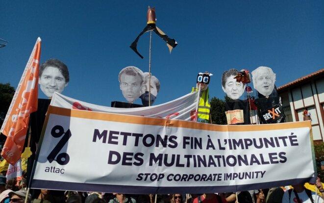 Manifestation contre le G7 et l'impunité des multinationales. © Attac