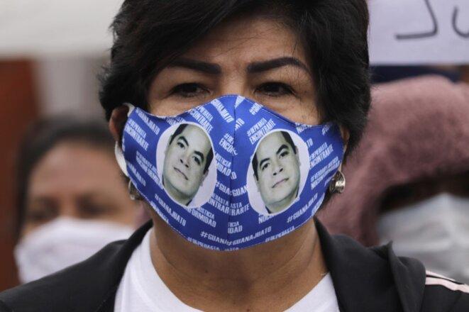 Des proches de disparus à Mexico le 11 juin. © NurPhoto/AFP
