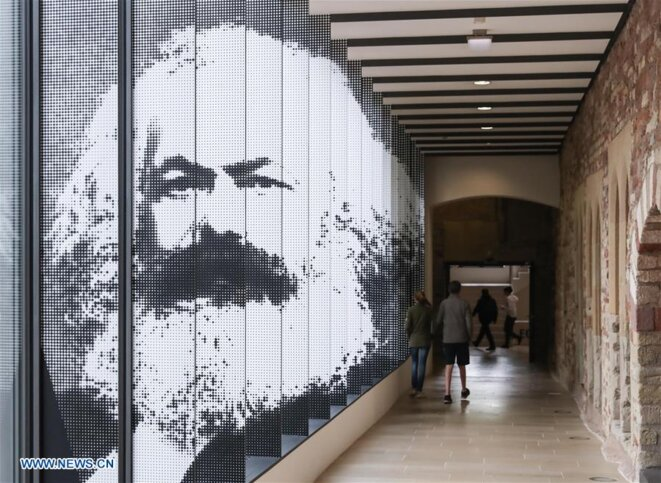 """Entrance of the exhibition """"Karl Marx 1818-1883. Life. Work. Time."""" in the City Museum Simeonstift Trier in Trier, Germany, May 3, 2018. © Xinhua/Shan Yuqi"""