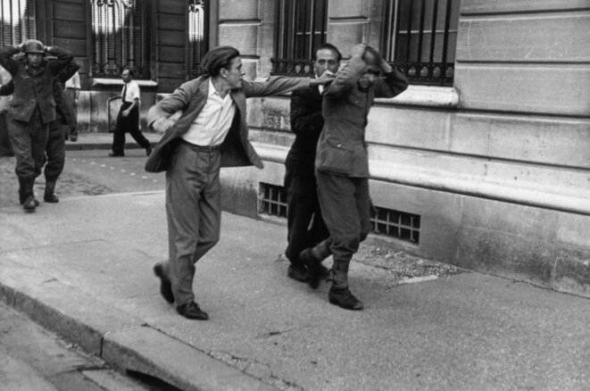 Parisan street fighter who is unable to contain his wrath against a German soldier, August 25th, 1944.