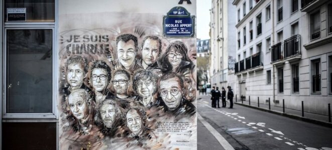 A mural close to the offices of Charlie Hebdo magazine depicting the victims of the January 2015 attack. © Stephane de Sakutin,/AFP