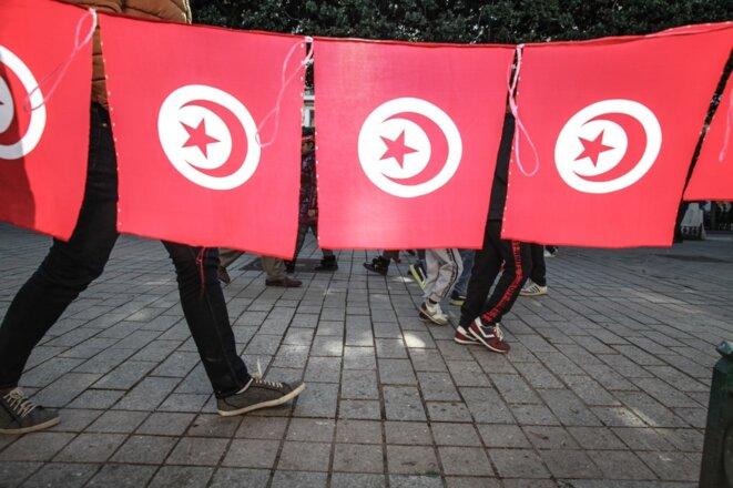 Des Tunisiens Avenue Habib Bouguiba à Tunis pendant la célébration du neuvième anniversaire de la révolution le 14 janvier 2020. © Chedly Ben Ibrahim /Hans Lucas /AFP