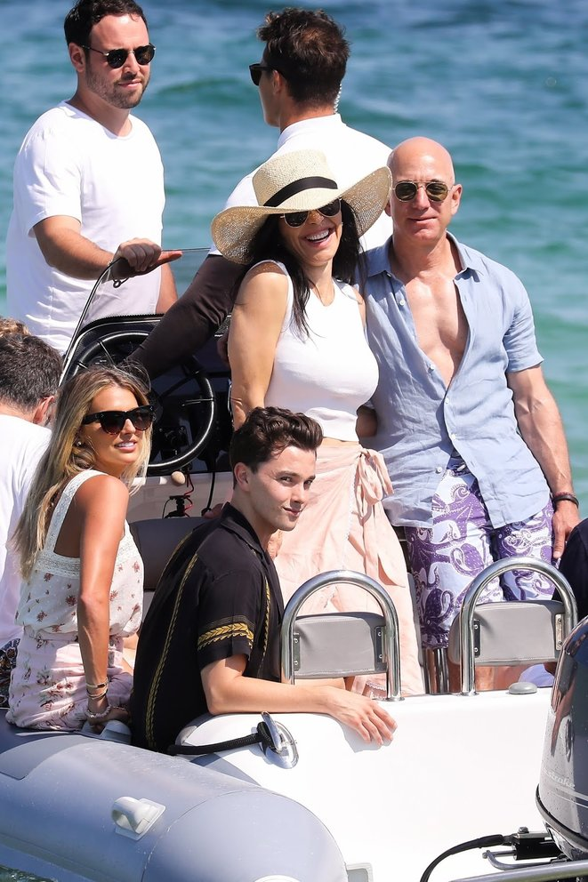 Mr. Bezos, wearing the $260 purple octopus swim trunks, with Ms. Sanchez in St. Tropez in August, 2019. © New York Times