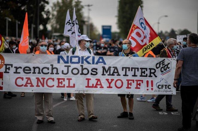 Devant le siège de Nokia France à Nozay (Essonne), le 10 septembre. © Martin BUREAU / AFP