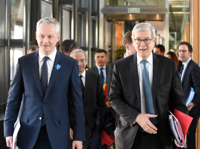 Bruno Le Maire et Philippe Varin, président du conseil de Suez, à Bercy en 2018. © AFP