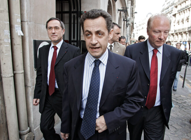 Left to right: Claude Guéant, Nicolas Sarkozy and Brice Hortefeux in June 2005. © PASCAL PAVANI / AFP