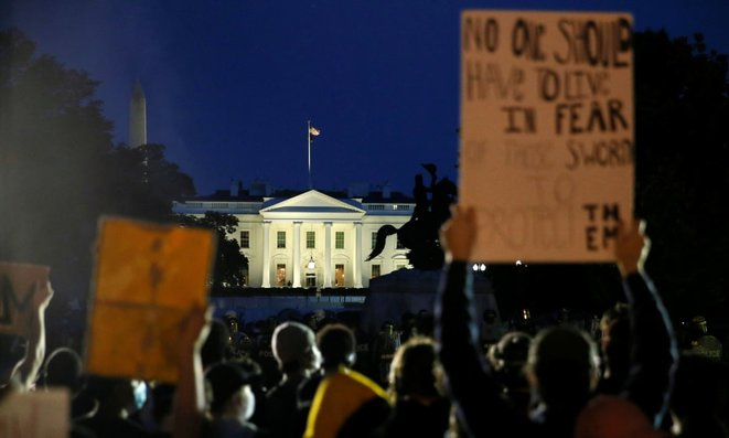 Crowds protest outside the White House. © Photograph: Jim Bourg/Reuters