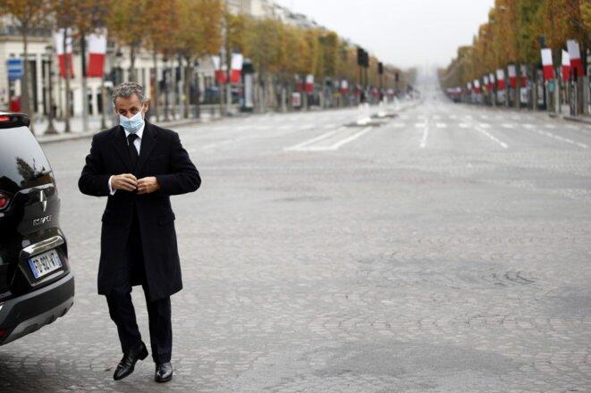 Nicolas Sarkozy à son arrivée devant l'Arc de Triomphe, le 11 novembre 2020. © Yoan Valat / AFP