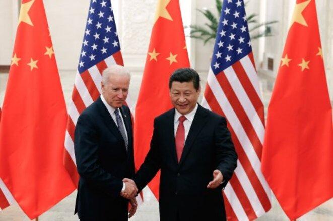 Joe Biden et Xi Jinping en décembre 2013 à Pékin. © Lintao Zhang / AFP