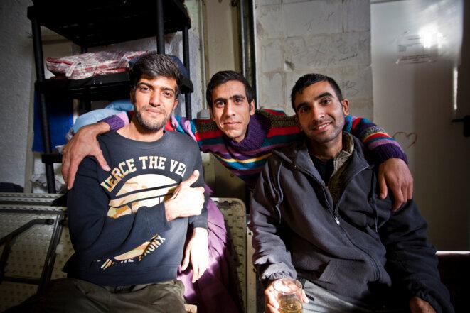 Trois exilés heureux d'avoir réussis à passer la frontière © Durand Thibaut