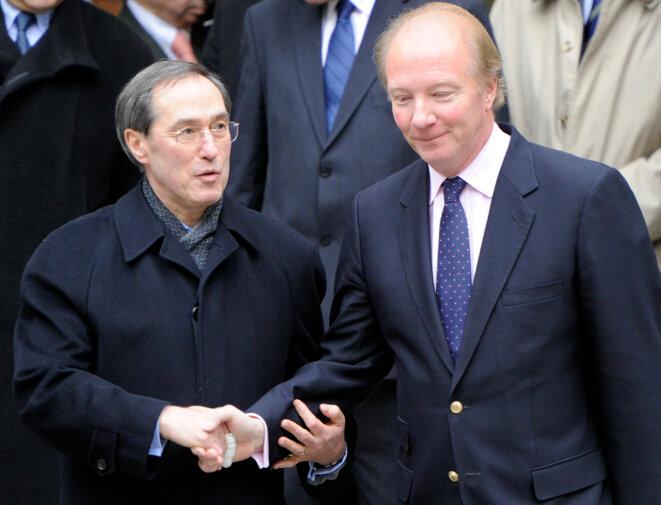 Claude Guéant et Brice Hortefeux, en février 2011, au ministère de l'intérieur. © LIONEL BONAVENTURE/AFP