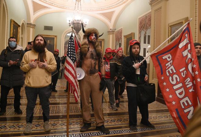 Des partisans de Trump dans le Capitole mercredi 6 janvier. © Saul Loeb/AFP
