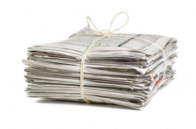 depositphotos-19516717-stock-photo-pile-of-newspapers