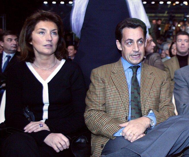 Cécilia Attias (alors Sarkozy), en novembre 2002, avec son mari au congrès fondateur de l'UMP. © FRANCOIS GUILLOT/AFP