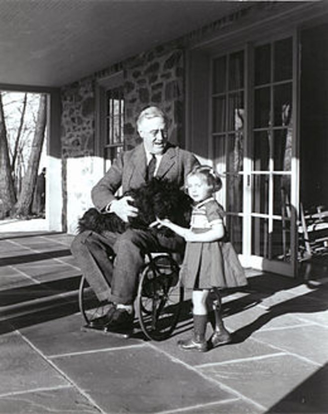 Rare photograph of Roosevelt in a wheelchair, with Ruthie Bie and Fala (1941).