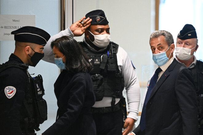 Nicolas Sarkozy à son arrivée au tribunal, le lundi 1er mars. © Anne-Christine Poujoulat / AFP