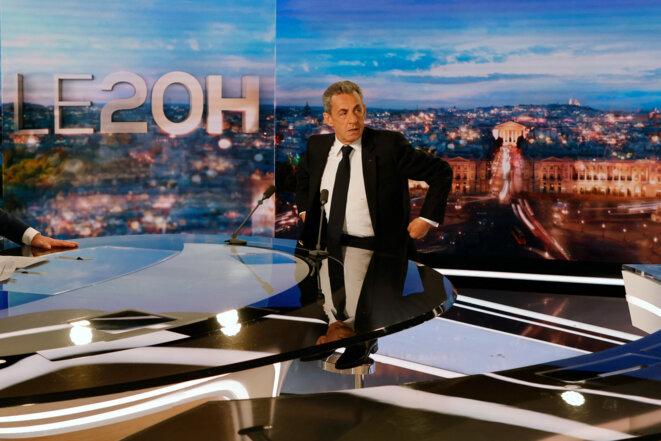 Nicolas Sarkozy, le 3 mars 2021, prenant place avant le « 20 Heures » de TF1. © Ludovic MARIN / AFP