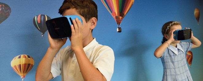 two-children-wearing-virtual-headsets