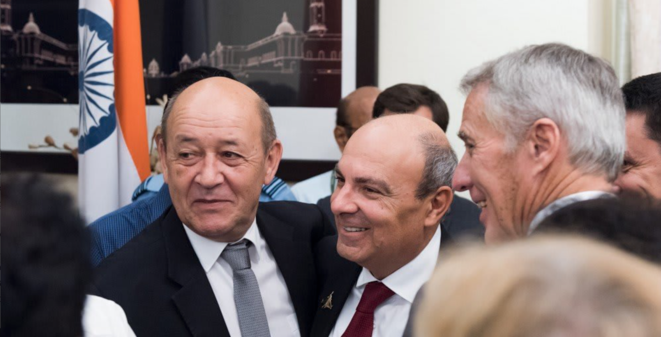 Then French defence minister Jean-Yves Le Drian (left) celebrates with Dassault Aviation CEO Éric Trappier, (centre) following the signing of the contract for the 36 Rafale fighter jets sale to India, in New Delhi on September 23rd 2016. © Dassault Aviation